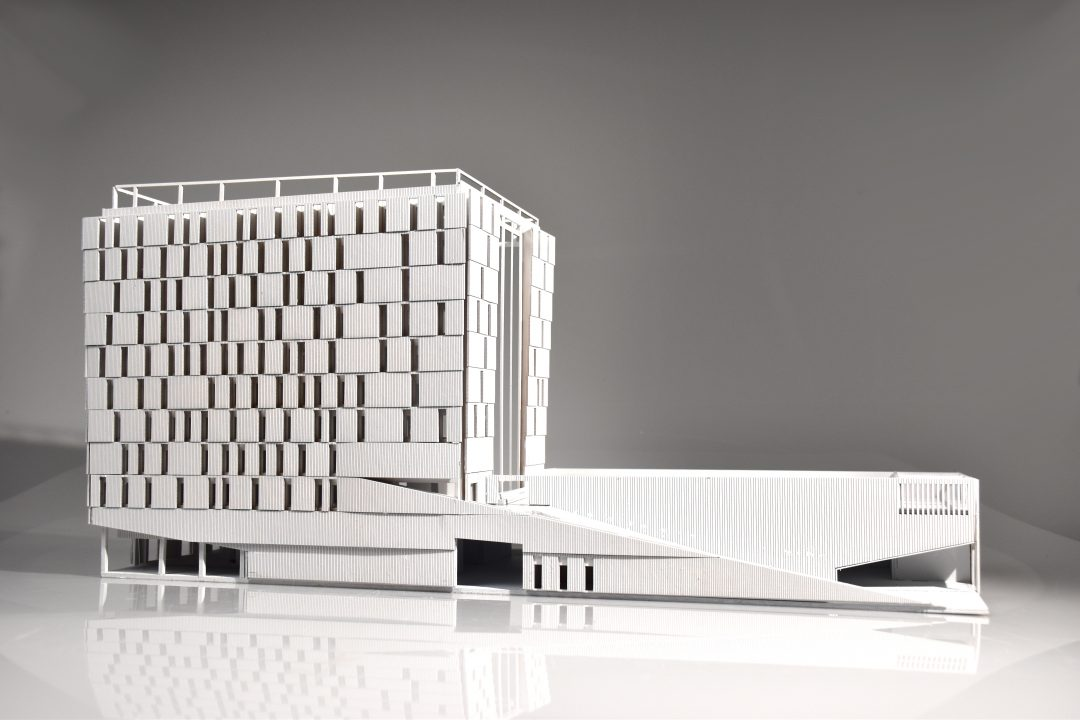 Photograph of a white physical model of a multiple story building