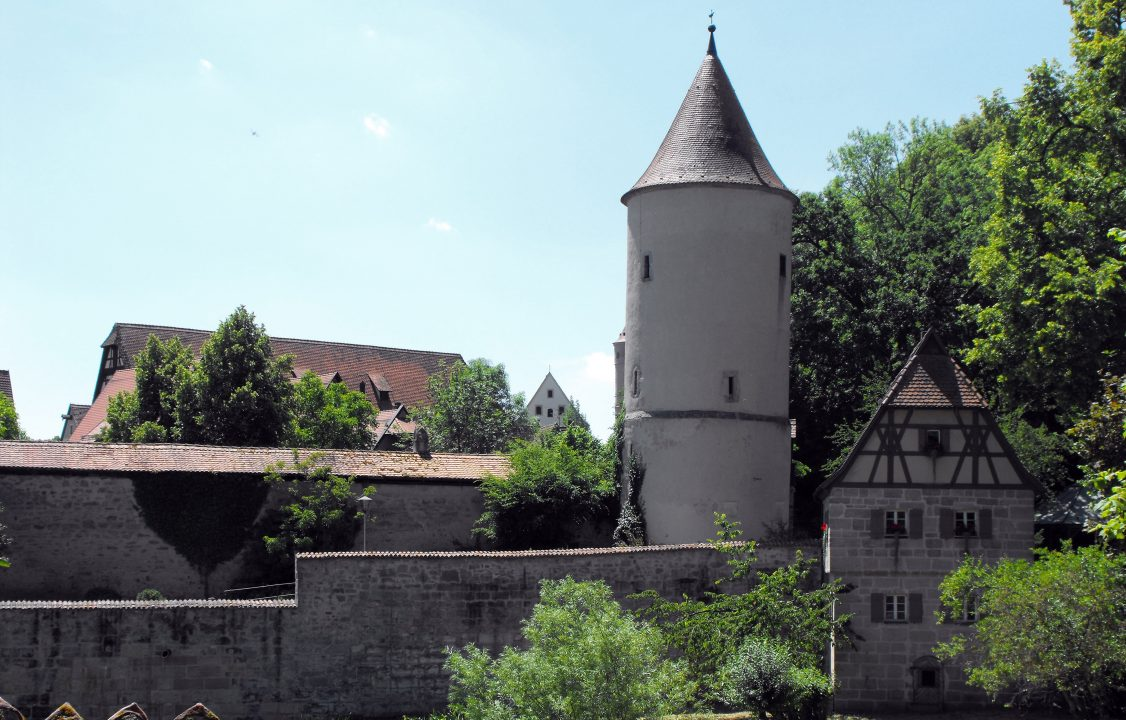 Photograph of a spiral tower and stone buildings