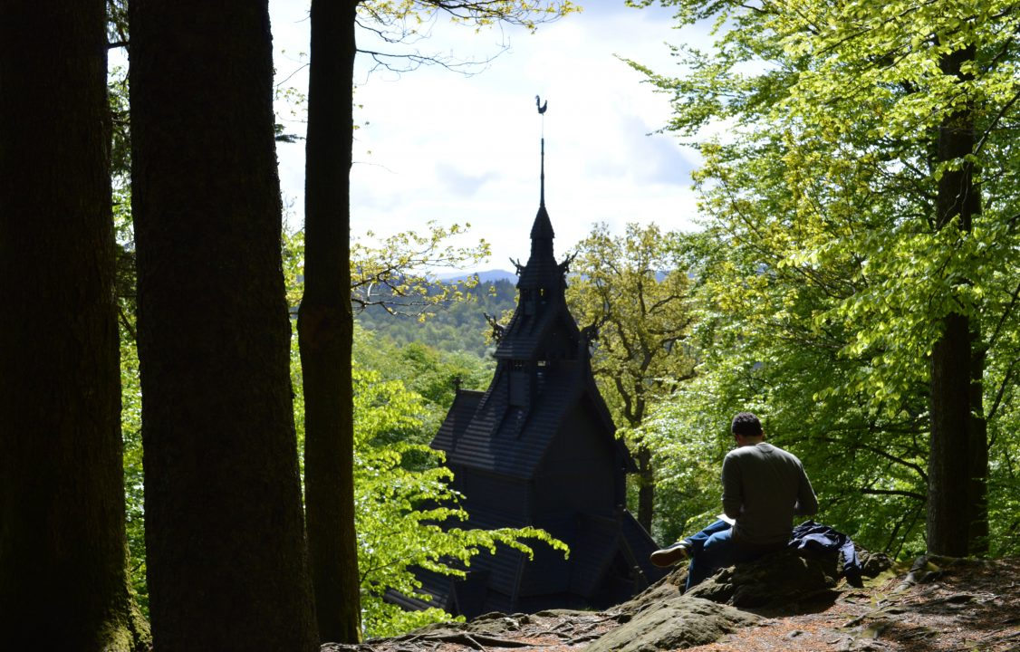 Photograph of a church like structure in the woods