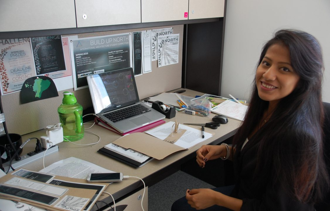 Photograph of a student in an office working on a computer