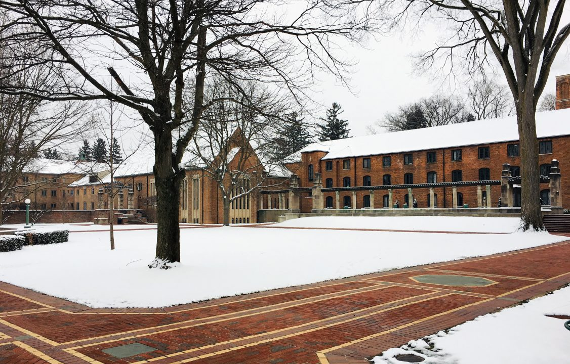 Photograph of buildings surrounding a courtyard in the winter