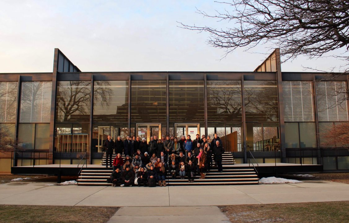Photograph of students on the stairs outside a famous building