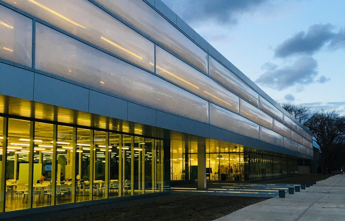 Photograph of the exterior of a building with a glass facade