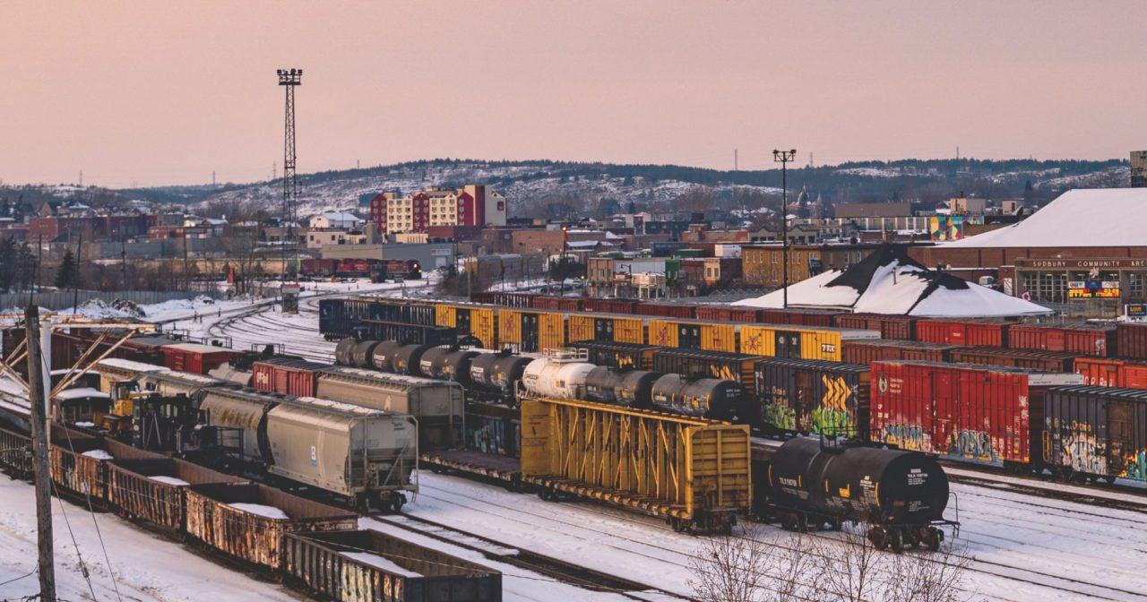 Photograph looking down on a train yard in the winter